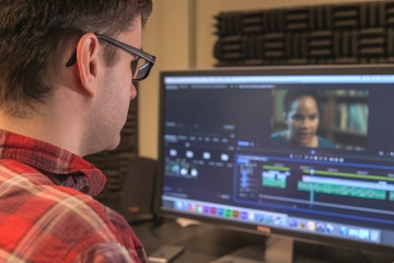 a student edits a video production piece in Adobe Premiere Pro software