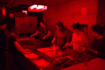 students in darkroom processing photos