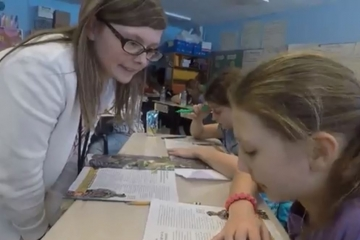a fredonia student teaches children in a local classroom