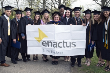 The enactus club poses for a group photo at commencement