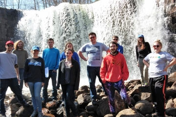 fredonia geology students pose in front of a waterfall