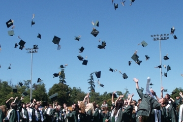 hats tossed into the air at commencement ceremony
