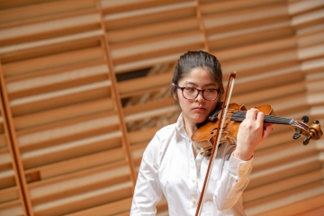 a student playing violin