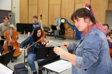 Future music teachers serve as both student and instructor in a small-group practice in Mason Hall.