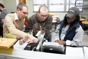a fredonia professor helps a student with a project