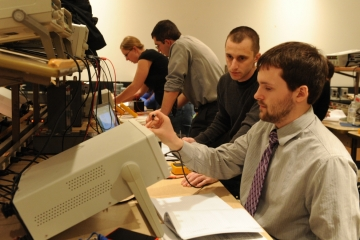 fredonia physics students work on a project