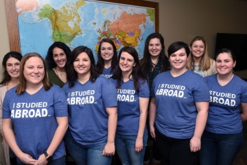 "study abroad students pose for a photo wearing a shirt that says ""I studied abroad"""