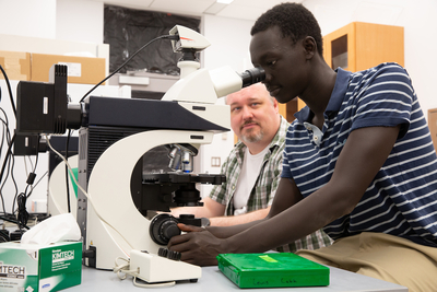 Biology student works with faculty in Science Center lab