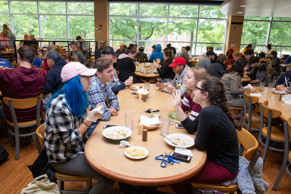 students chat while they eat lunch in the seating area of Cranston Marche