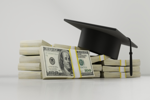 a photo of a pile of money and a graduation cap