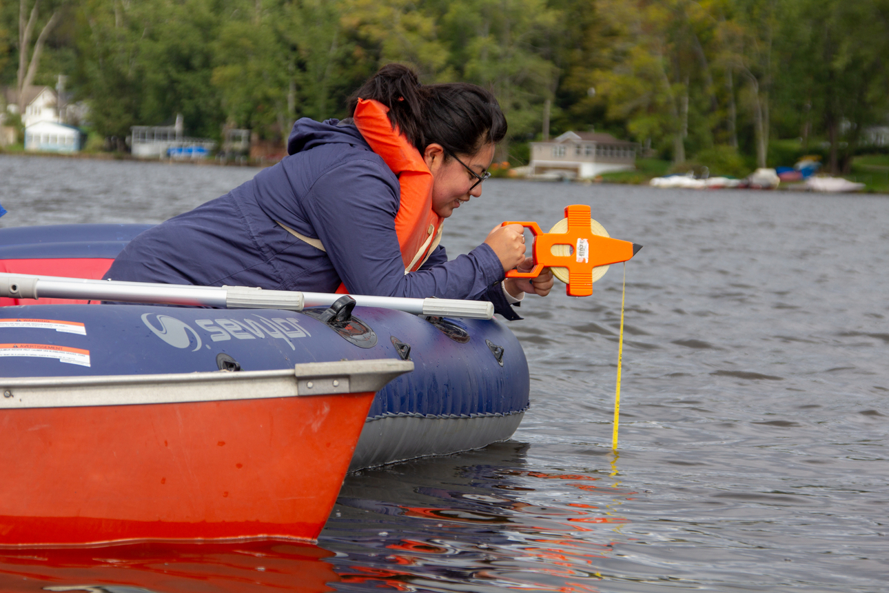 Students in Dr. Courtney Wigdahl-Perry's Aquatic Biology class collect water samples from Bear Lake.