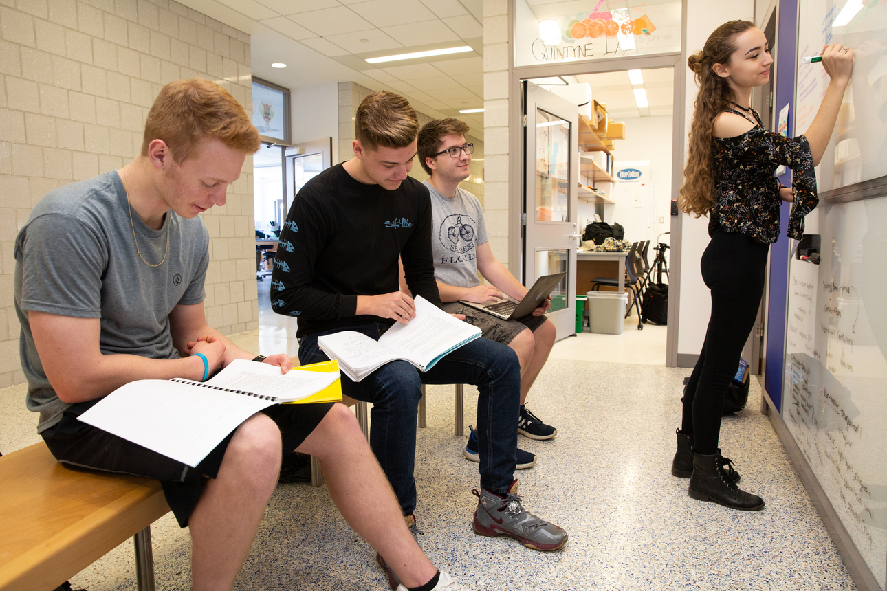 students collaborate in the study alcove
