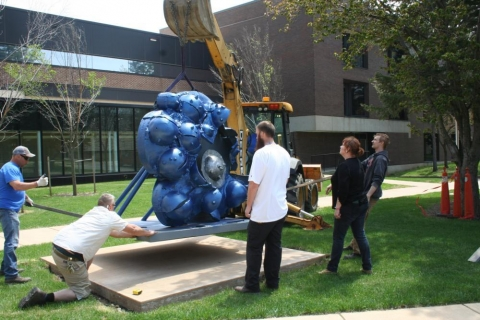 "Installation of ""Thunder Cloud,"" a cast iron sculpture by Coral Lambert."