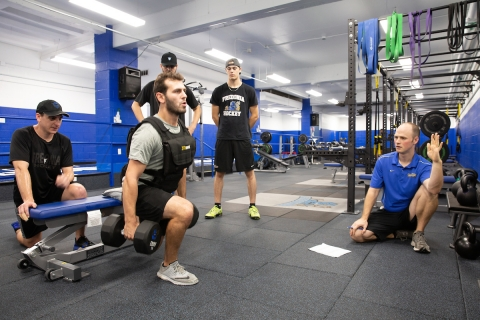 Athletes work out in the new performance center
