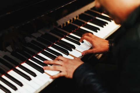 photo of hands on a piano keyboard